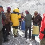 Yak herders weighting gear to be taken to next camp.