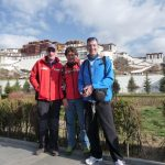 PJ, Derek and Noel outside the palace in Lhasa.